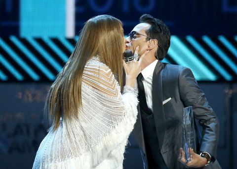 Jennifer Lopez and Marc Anthony kiss on stage at the Latin Grammys